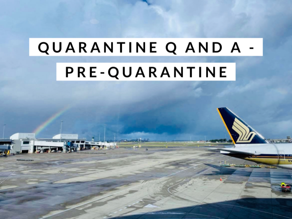 singapore airlines plane on runway with rainbow