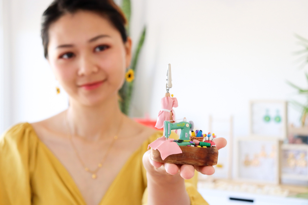 woman holding polymer clay sculpture